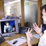 Deaf or HOH person and video interpreter communicate in ASL