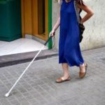 Student walking with white cane